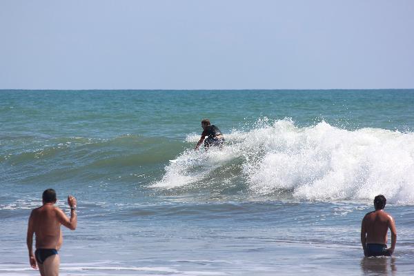 Kyler surfing